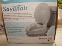 Savanah adjustable toielt seat with lid , raised seat for people with health problems. still in box.