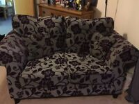 Good condition ,two,two seater sofas. Grey and purple .