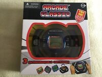 """BNIB, sealed, """"ARCADE CLASSIC"""" Game Console/Wheel with 3 interchangeable cartridges. Unwanted gift!"""