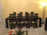 Magnificent black ash dining table with 8 chairs