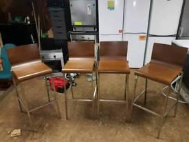 4 wooden and chrome bar stools