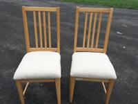 Pair Of solid beech dining chairs newly recovered vgc