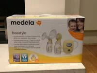 Medela Freestyle electric 2 phase breast pump and extras