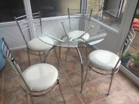 Glass topped table and 4 chairs