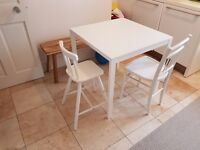 Two painted white, wood dining chairs = one for adult and one for child (IKEA AGAM junior)