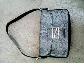 Small black and silver handbag. Not been used. £2