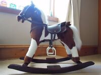 Beautiful soft rocking horse, lovely detailed features and accessories