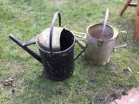 Old fashioned watering cans used for planters