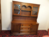 solid heavy brown wood dresser with glass doors at the top