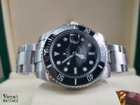 Rolex Submariner - Silver Bracelet with Black Face and Black Bezel. Box and Paperwork Included.