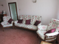 An Ercol 3 piece suite consisting of a 3 seater settee and 2 chairs.