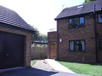 TWO BED GROUND FLOOR APARTMENT, GARAGE AND GARDENS.