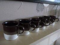 Set of mugs with wooden mug tree