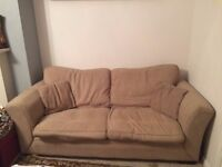 FOR SALE: 2 seat sofa plus single seat couch and a coffee table. Can sell individually too