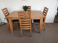Solid Oak 8 seater dining table and 4 chairs