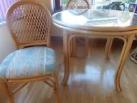 Round Glass Top Cane table with 4 matching chairs. Excellent condition
