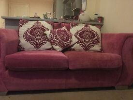 2 x 2 seater pink pillow back sofas - must sell