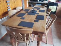 Solid wooden kitchen table with 6 matching chairs