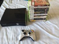 Xbox 360 slim with 15 games, pad and all leads