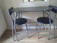 Black glass and metal table and two chairs