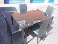 dinning table black glass top and 4 chairs