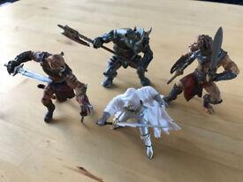 Fantasy figures: tiger, rhino, lion, warrior