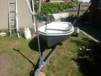 Row boat/tender with seagull outboard and trailer