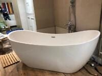 Free-standing white acrylic double ended bath. Modern