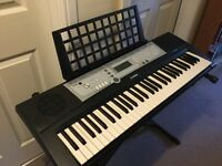 Yamaha YPT-200 keyboard and stand