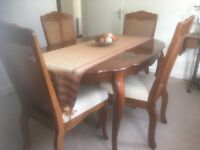 For sale rosewood dining room table with 6 chairs and unit.