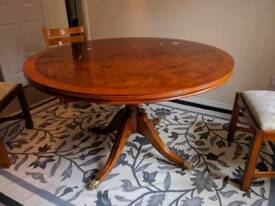 Extendable antique dining table and chairs