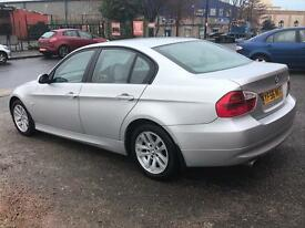 BMW 320i automatic *64k low warranted miles*priced to sell
