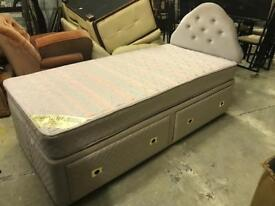 Pair of single storage divan beds with mattresses and headboards