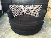 Beautiful DFS fabric swivel love chair •free delivery