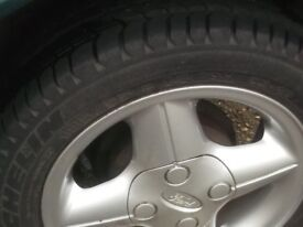set of 4 alloy wheels fit 1999 fiesta or later, or fit ka