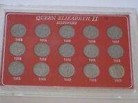 Queen Elizabeth II Sixpences set in a case dating 1953-1967