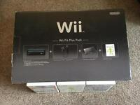 Wii + Wii fit plus pack + rechargeable battery pack