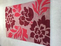 Red, burgundy and brown floral rug