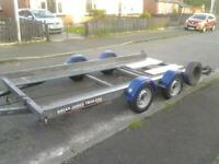 brian james car transporting trailer