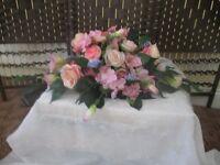 I make silk and foam wedding flowers and venue decoration