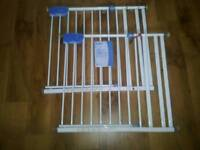 Pair stair safety gates