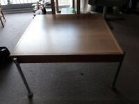 Wooden coffee table with metal legs in good condition