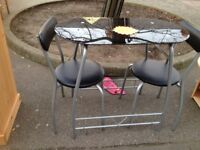 LOVELY BLACK GLASS TABLE AND 2 CHAIRS IN VERY GOOD CONDITION
