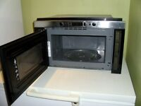 Ikea 750w microwave fits into 60cm wide cupboard, silver and black