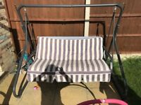 Three seater garden swing chair - used. Sun canopy included but not pictured