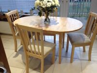 SMALL PALE WOOD DINING TABLE WITH FOUR CHAIRS