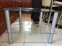 Clear tempered glass and chrome tv stand.
