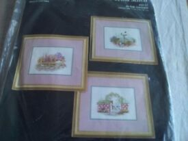 New counted cross stitch kit by Janlynn. Picture is called In the Garden with 3 small pictures.