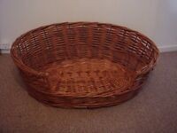 Wicker pet dog basket good condition call or text 07754491013 can possibly deliver