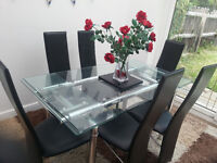 glass dining table and six leather chairs